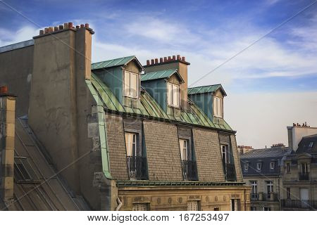 The Chimney Pots of Paris Rooftops With Blue Cloudy Skies