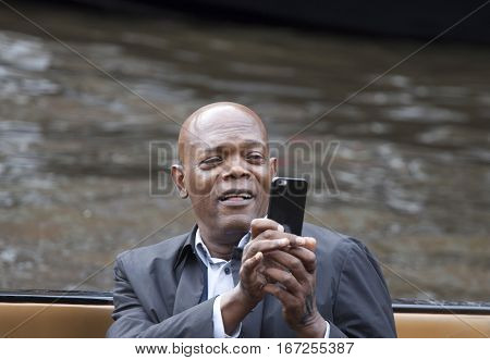 AMSTERDAM, THE NETHERLANDS ,JULY 10 2016; Famous american actor Samuel L Jackson  in a large speedboat while shooting his latest film