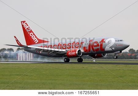 AMSTERDAM, THE NETHERLANDS - SEPTEMBER 25, 2016: Boeing 737-330 manchester jet has just landed on the Polder runway with light smoking tires