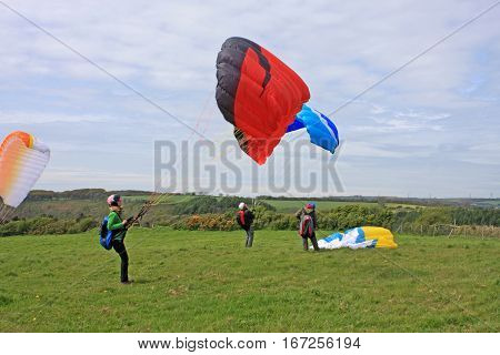 Paragliders launching their wings for take off