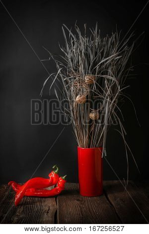 Still Life with Red Hot Chili Peppers on wooden background