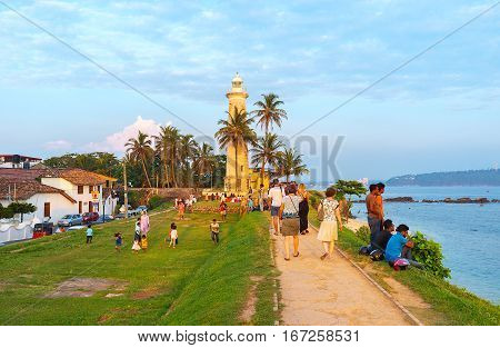 GALLE SRI LANKA - DECEMBER 3 2016: The rampart walk is the popular tourist attraction people enjoy the seascape and city landmarks on December 3 in Galle.