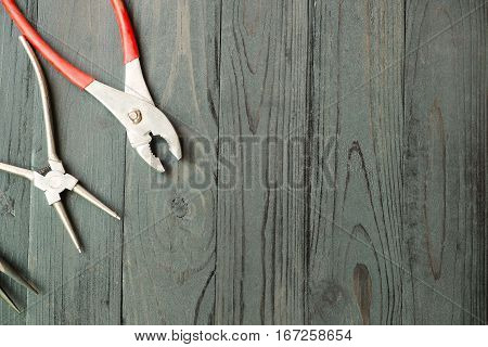Pliers for remove the snap ring Pliers on black wood