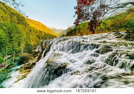 Beautiful View Of The Pearl Shoals Waterfall Among Mountains