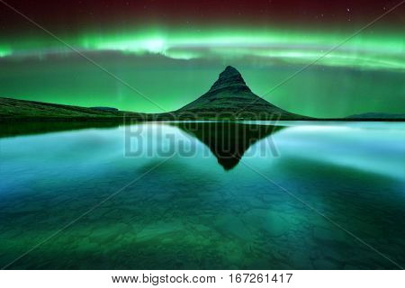 Green aurora light behind kirkjufell mountain in Iceland, Europe. Courtesy of NASA