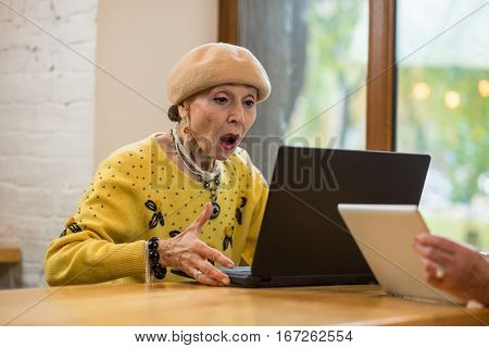 Surprised senior woman and laptop. Old lady with open mouth. New technologies are amazing.
