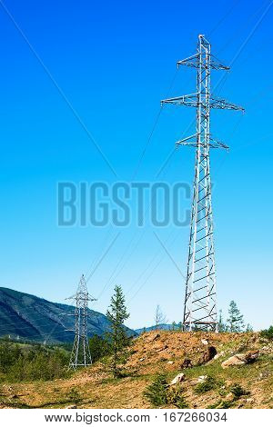High voltage power lines in mountainous terrain
