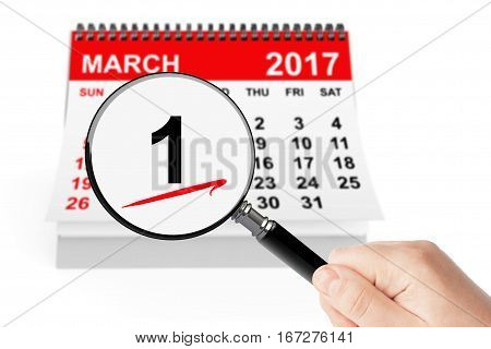 First Spring Day Concept. 1 march calendar with magnifier on a white background
