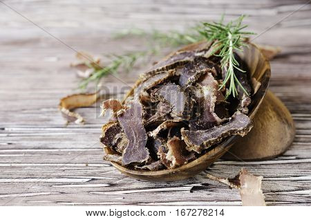 Jerked Meat, Cow, Deer, Wild Beast Or Biltong In Wooden Bowls On A Rustic Table
