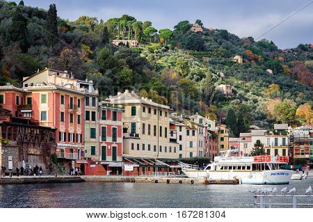 PORTOFINO, ITALY - DECEMBER 2016: View on Portofino town with color architecture, located between mountains in Italian Liguria, Italy.