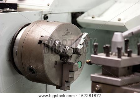 detail of clamping head of a lathe