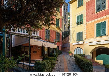 PORTOFINO, ITALY - DECEMBER 2016: Narrow street of Portofino town with traditional color architecture and beautiful cafes