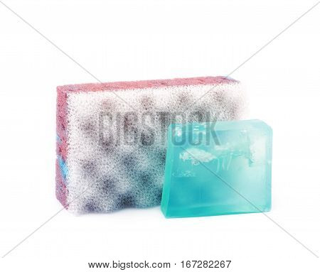Purple bathing sponge next to a blue piece of soap, composition isolated over the white background
