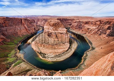 Horseshoe Bend which is a horseshoe shaped meander of the Colorado River located near the town of Page, Arizona in the United States.  Horseshoe Bend is part of the Glen Canyon National Recreation Area under the National Park Service.