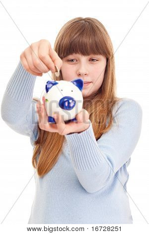 lovely teenage girl putting coin in piggy bank close up poster