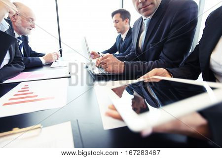 Business people at meeting analyzing financial figures denoting the progress in the work of the company
