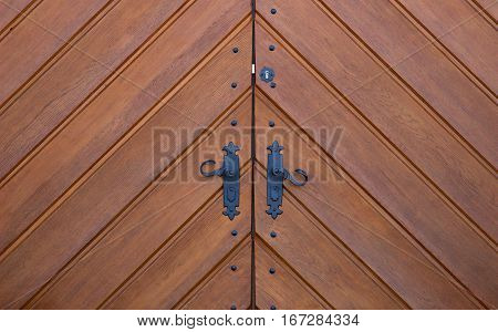 big old oak wood door with nice decorative fitting black painted brown paint