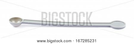 Chemistry measurement spoon isolated over the white background