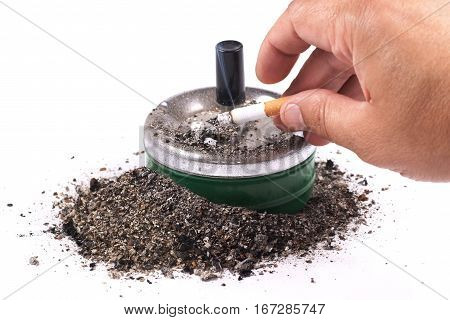 Palm flicking cigarette ash in the ashtray