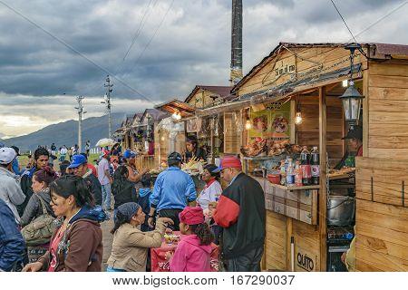 QUITO, ECUADOR, FEBRUARY - 2016 - People at ecuadorian food street market stands located in the famous panecillo landmark in Quito Ecuador.