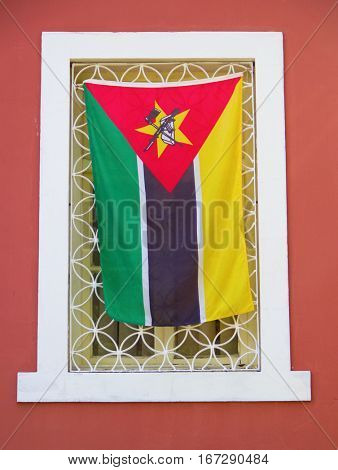 National falg in the window of governmental office in Maputo, Mozambique