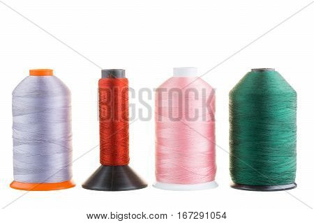 Spools Of Silk Thread In A Row Isolated