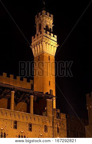 The Torre del Mangia at Night 87 m. (Tower of Mangia) 1348. In the ancient city of Siena Toscana (Tuscany) Italy