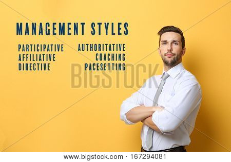 Management styles concept. Young businessman on yellow background
