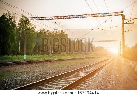 Railways at the dusk in forest, Russia