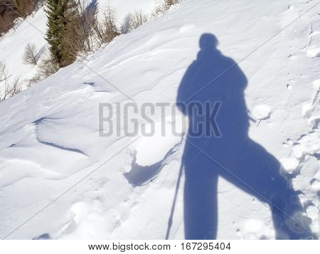 Cimadera Cima Fojorina Switzerland: shadow on the snow to the mountain of Lombardy on the border between Italy and Switzerland.