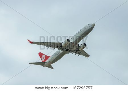 Borispol Ukraine - October 2 2011: Turkish Airlines Boeing 737-800 is taking off into cloudy sky
