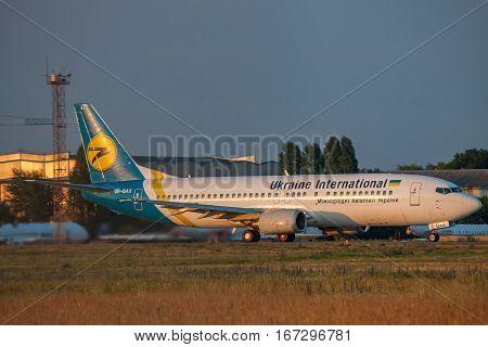 Borispol Ukraine - September 9 2011: Ukraine International Airlines Boeing 737-400 passenger plane is taking off on sunset