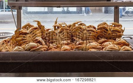 Cooked crabs in the refrigerator.  Shot of many cooked crabs waiting to be purchased.
