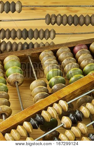 Different vintage wooden abacus on wooden background