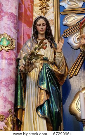 KRAPINA, CROATIA - APRIL 21: Immaculate Heart of Mary statue at the altar in the church of Saint Catherine of Alexandria in Krapina, Croatia on April 21, 2016.