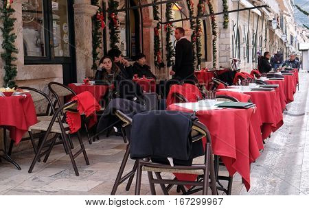 DUBROVNIK, CROATIA - DECEMBER 01: People sits in restaurant on the Old Town of Dubrovnik, Croatia on December 01, 2015.