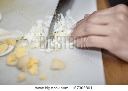 Human hands preparing food at the kitchen