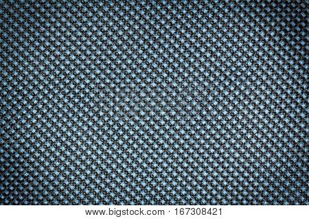 Blue fishnet cloth material as a texture background. Nylon texture pattern or nylon background for design with copy space for text or image. Dark edged.