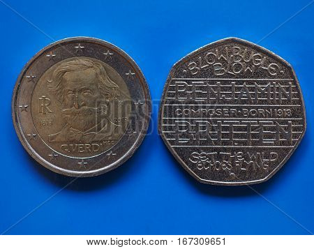 Two Euros And 20 Pence Coin Over Blue
