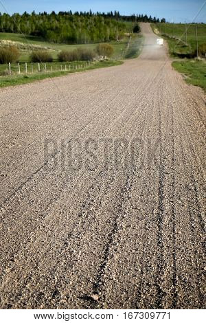 Old dirt country road with gravel for trucks and travel