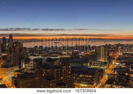 San Francisco, California, USA - January 14, 2017:  Early morning sunrise glow above San Francisco bay.