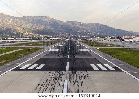 Burbank, California, USA - January 26, 2017:  Skid marks on runway at Burbank airport in Los Angeles County, California.