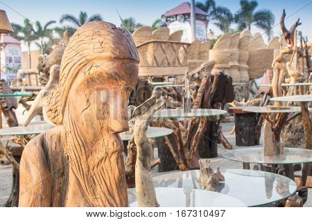 Wooden sculpture face of world famous poet Rabindranath Tagore tables with glass on top handicrafts on display during the Handicraft Fair in Kolkata earlier Calcutta West Bengal India.