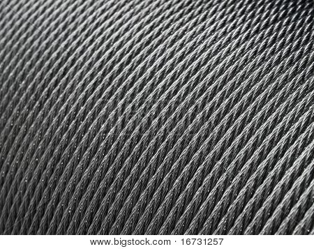 Steel rope coil - abstract industrial background.