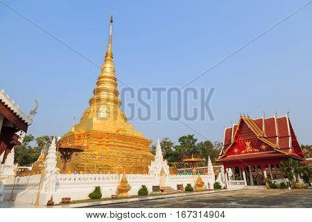 NAN THAILAND - 17 FEBRUARY 2015 - Golden pagoda named Phra That Chae Haeng and red gazebo in Nan province Thailand