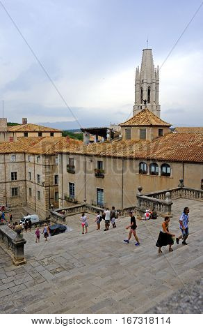 Girona, Spain - August 2, 2014: Visitors explore the medieval district of Girona, Catalonia, Spain