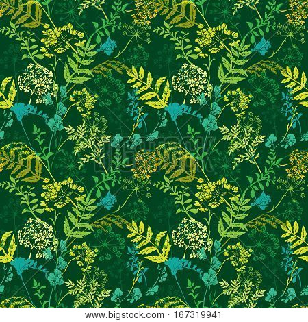 Seamless pattern with wild flowers and grass silhouettes on green background.