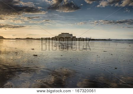Island of fort national from the beach and sunset reflection Saint-Malot Bretagne France