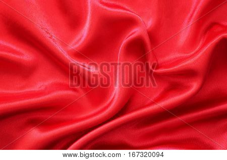 Red silk fabric draped in the form of heart for Valentine's day background