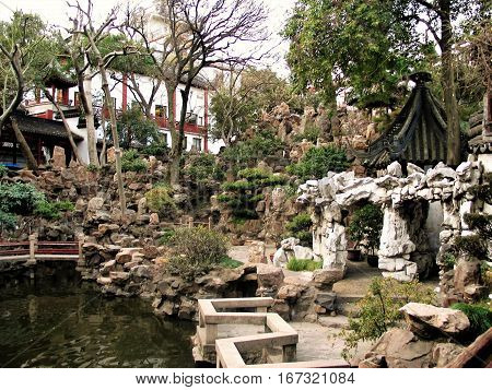 macro photo with the background of the old Park with natural boulders and landscape architectural elements decorations in the Chinese city of Shanghai as the source for design, printing, advertising